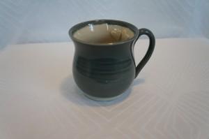 grå kop oppe
